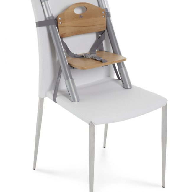 SCI SVAN Scandinavian Child Natural Lyft Baby Booster Seat on White Chair