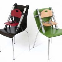 SCI SVAN Lyft Booster Seat Natural on Green Chair and Red on Espresso Chair