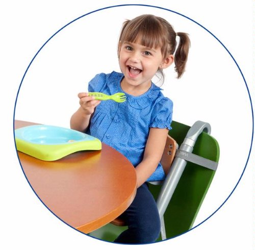 SCI SVAN Lyft Booster Seat Natural on Green Chair with Girl at Table