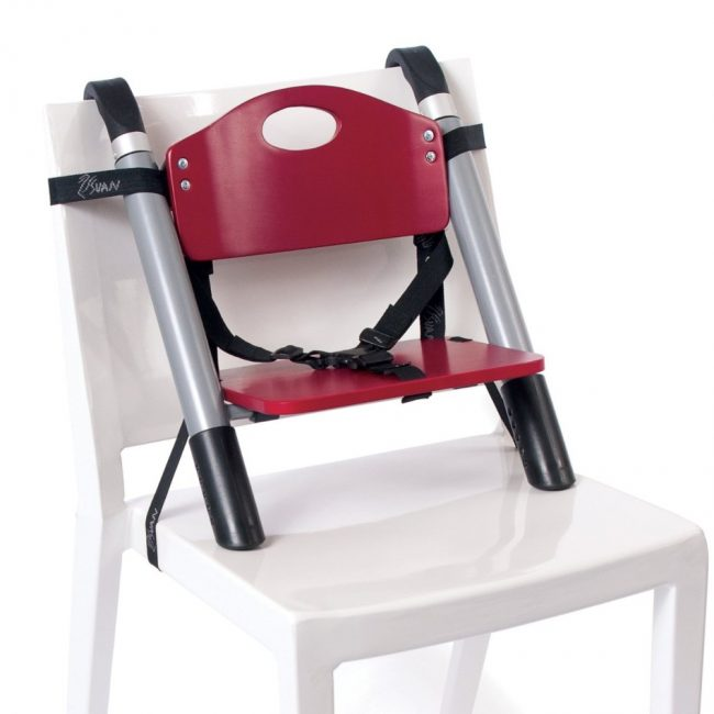 SCI SVAN Scandinavian Child Lyft Booster Seat Red on White Chair