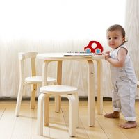 SCI SVAN Scandinavian Child Play With Me Toddler Table + Chairs Set Natural baby holding onto Table