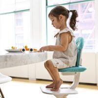 SCI SVAN Scandinavian Child Whitewash Signet Essential Highchair girl in turquoise cushion